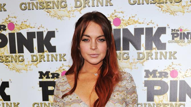 FILE - In this Oct. 11, 2012 file photo, Lindsay Lohan attends the Mr. Pink Ginseng launch party at the Beverly Wilshire hotel in Beverly Hills, Calif.  Lohan's misdemeanor case is due to be called for arraignment in Los Angeles on Tuesday, January 15, 2012. The actress is charged with lying to police, reckless driving and obstructing a police officer from performing his duties. (Photo by Richard Shotwell/Invision/AP, File)