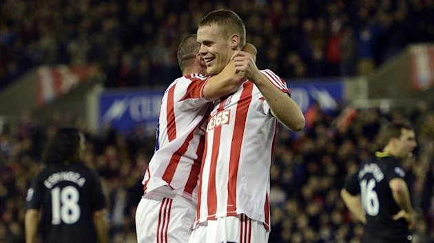 Stoke City's English defender Ryan Shawcross (R) celabrates scoring the opening goal with English-born Irish sstriker Jonathan Walters during the English Premier League football match between Stoke City and Wigan Athletic at The Britannia Stadium (AFP)