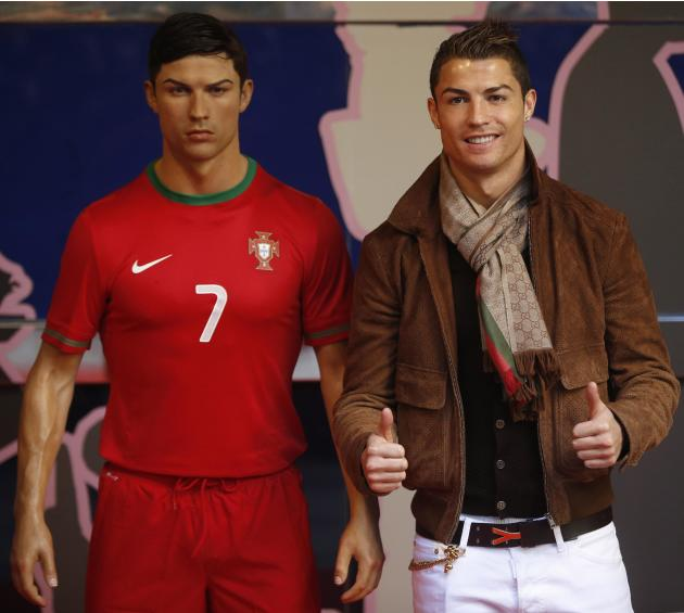 Cristiano Ronaldo, who plays for Real Madrid and Portugal's national soccer team, poses with his wax statue after an unveiling ceremony at the Madrid Wax Museum