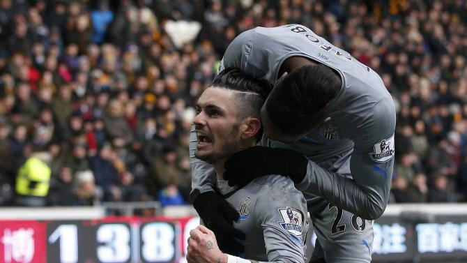 Newcastle United's Remy Cabella celebrates his goal with teammate during their English Premier League soccer match against Hull City at the KC Stadium in Hull