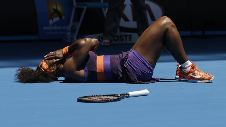 Serena Williams of the US lies on the court after falling during her first round match against Romania's Edina Gallovits-Hall  at the Australian Open tennis championship in Melbourne, Australia, Tuesday, Jan. 15, 2013. (AP Photo/Rob Griffith)