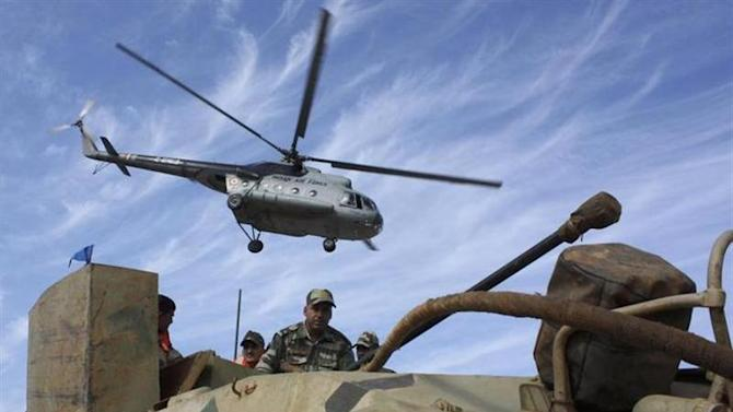 An Indian Air Force Mi-8 helicopter takes part in a joint amphibious warfare exercise by the Indian armed forces at Madhavpur beach along the Arabian Sea, about 475 km (295 miles) west of Ahmedabad, February 9, 2009. REUTERS/Amit Dave/Files