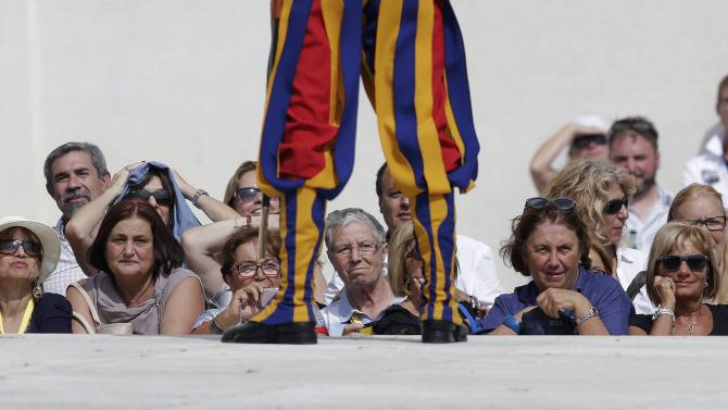 Faithfuls attend Pope Francis' Wednesday general audience in Saint Peter's square at the Vatican