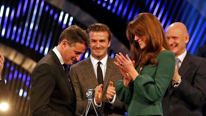 Kate, the Duchess of Cambridge applauds after presenting Lord Sebastian Coe with the Lifetime Achievement Award during the BBC Sports Personality of the Year Awards 2012 in London, Sunday Dec. 16, 2012. (AP Photo/David Davies, PA) UNITED KINGDOM OUT: NO SALES: NO ARCHIVE