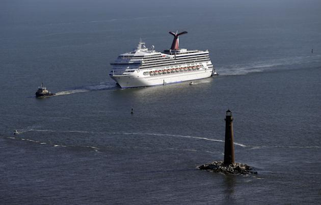 The disabled Carnival Lines cruise ship Triumph is towed to harbor off Mobile Bay, Ala., Thursday, Feb. 14, 2013. The ship with more than 4,200 passengers and crew members has been idled for nearly a