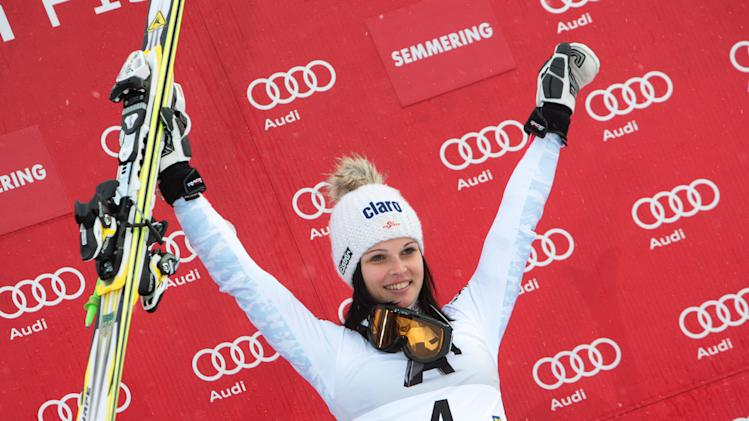 First placed Austria's Anna Fenninger celebrates on the podium at the end of an alpine ski, women's World Cup giant slalom in Semmering, Austria, Friday, Dec. 28, 2012. (AP Photo/Pier Marco Tacca)