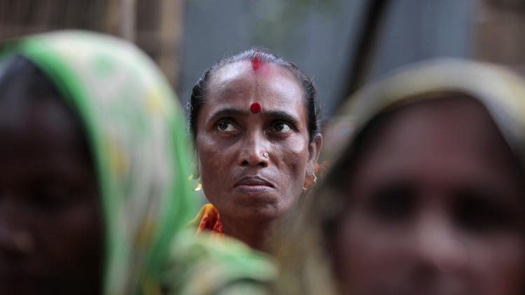 "In this Sept. 30, 2012, photo, Bangladeshi woman Shemoli Rani Das listens at their usual weekly meetings at Saghata, a remote impoverished farming village in Gaibandha district, 120 miles (192 kilometers) north of capital Dhaka, Bangladesh. Dozens of ""Info Ladies"" bike into remote Bangladeshi villages with laptops and Internet connections, helping tens of thousands of people - especially women - get everything from government services to chats with distant loved ones. (AP Photo/A.M. Ahad)"
