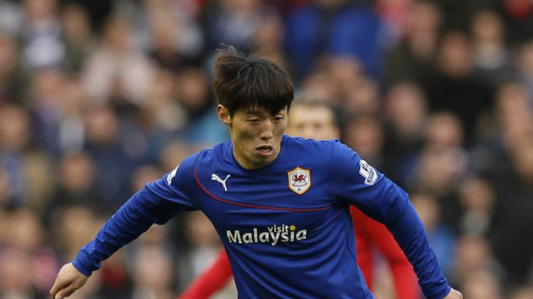 Cardiff City's Bo-Kyung Kim runs with the ball during their English Premier League soccer match against Liverpool at Anfield in Liverpool