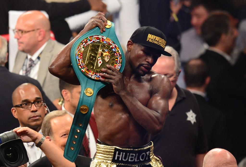 Mayweather pockets $100,000 after beating Pacquiao