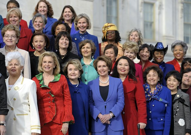 House Minority Leader Nancy Pelosi of Calif., front row, center, poses with other female House members on the steps of the House on Capitol Hill in Washington, Thursday, Jan. 3, 2013, prior to the off