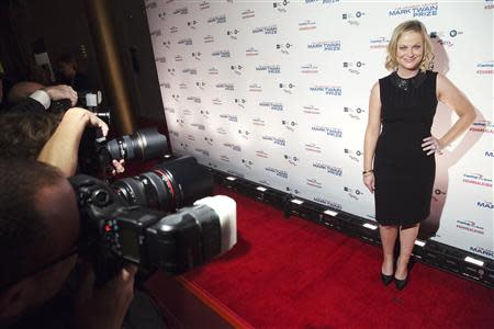Poehler arrives on the red carpet before the presentation of the Mark Twain Prize for American Humor to Burnett in Washington