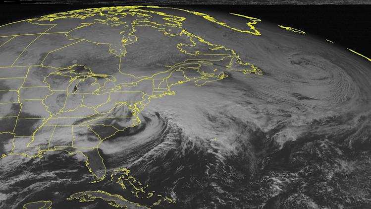 This NOAA satellite image taken Friday, Feb. 8, 2013 at 1:45 p.m. EST shows a major winter storm south of New England with heavy snow across the Northeast. A cold front extends back into the southeastern United States with rain showers. (AP Photo/Weather Underground)