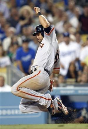 Giants beat Dodgers 2-1 to regain NL West lead