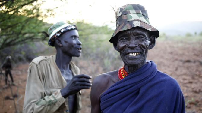 Turkana men stand outside a village inside the Turkana region of the Ilemi Triangle, northwest Kenya