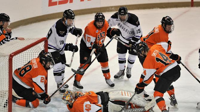 RIT goalie Jordan Ruby (40) lies on the puck during the third  period of a regional semifinal in the NCAA college hockey tournament Saturday, March 28, 2015, in South Bend, Ind. (AP Photo/Joe Raymond)
