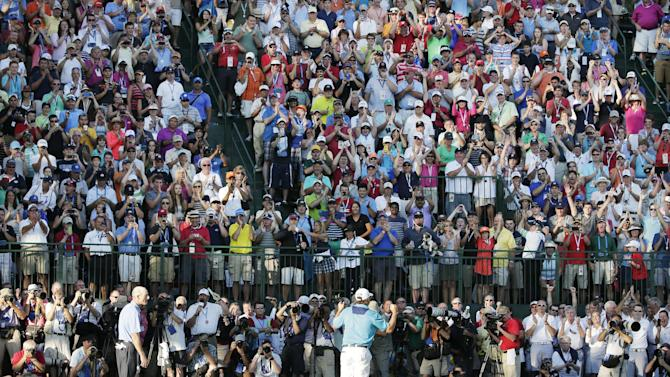 Jason Dufner, right, celebrates winning the PGA Championship golf tournament as Jim Furyk looks on at Oak Hill Country Club, Sunday, Aug. 11, 2013, in Pittsford, N.Y. (AP Photo/Charlie Riedel)