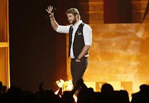 "Liam Hemsworth introduces a clip from ""The Hunger Games: Catching Fire"" at the 2013 MTV Movie Awards in Culver City, California"