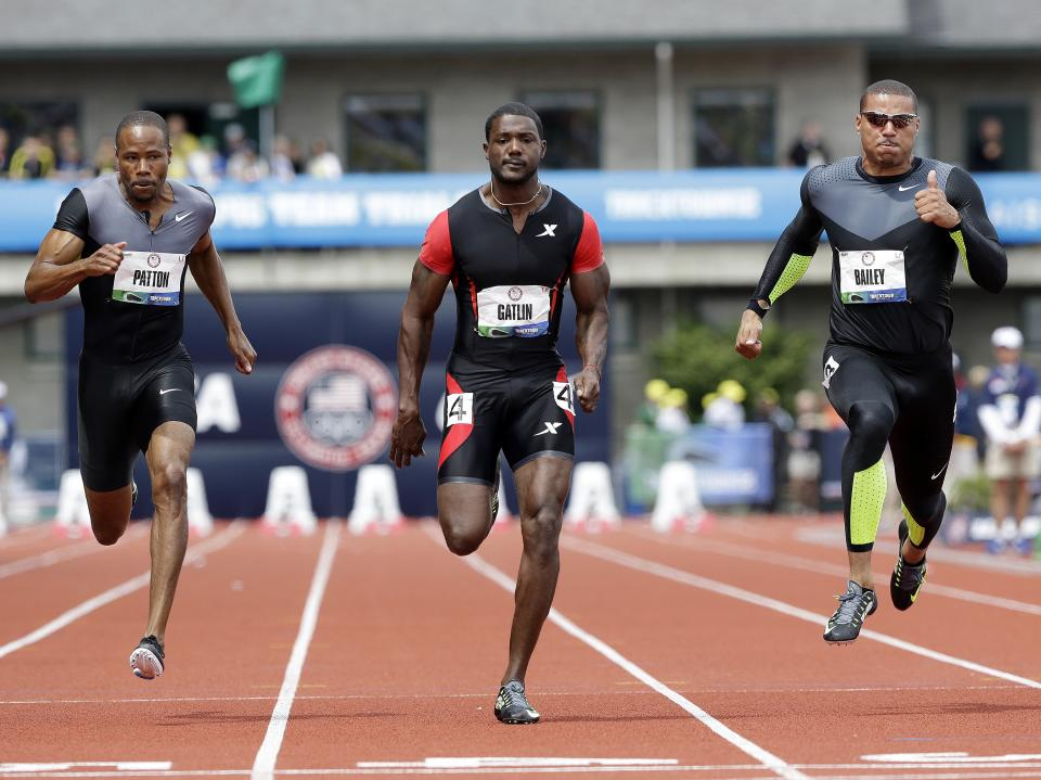 Justin Gatlin leads Darvis Patton and Ryan Bailey during a men's 100m semi final at the U.S. Olympic Track and Field Trials Sunday, June 24, 2012, in Eugene, Ore. (AP Photo/Eric Gay)