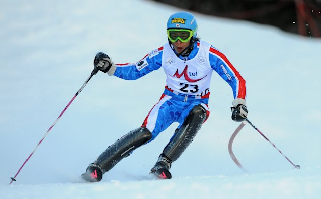 Naoki Yuasa of Japan clears a gate during the first run of the men's slalom at the FIS Alpine Skiing World Cup in Bansko on February 19, 2012.AFP PHOTO/SAMUEL KUBANI (Photo credit should read ILMARS Z