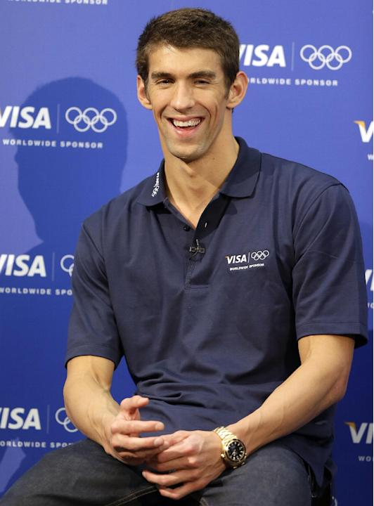 United States swimmer Michael Phelps smiles during a news conference at the 2012 Summer Olympics, London, Sunday, Aug. 5, 2012. (AP Photo/Kirsty Wigglesworth)