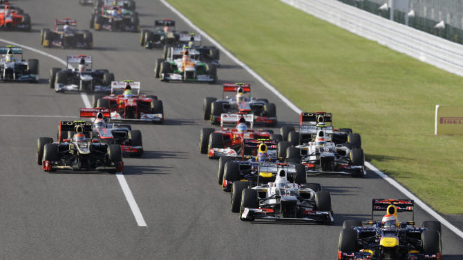 Red Bull driver Sebastian Vettel of Germany leads the field into turn one at the start of the Japanese Formula One Grand Prix at the Suzuka Circuit in Suzuka, Japan, Sunday, Oct. 7, 2012. (AP Photo/Greg Baker)