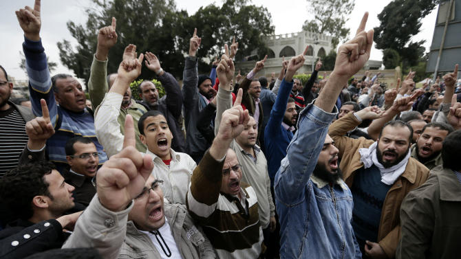 Supporters of Egyptian President Mohammed Morsi's chant slogans during a demonstration outside the presidential palace, in Cairo, Egypt, Wednesday, Dec. 5, 2012. Supporters of Morsi and opponents clashed outside the presidential palace. Wednesday's clashes began when thousands of Islamist supporters of Morsi descended on the area around the palace where some 300 of his opponents were staging a sit-in. (AP Photo/Hassan Ammar)