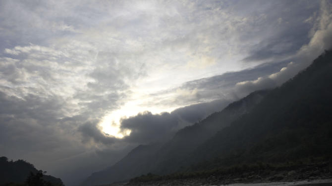 In this photo taken Saturday, Dec. 8, 2012, storm clouds develop above the aboriginal Kanakanvu mountain village of Dakanua, southern Taiwan. In a race against time, a dedicated Taiwanese linguist is trying to save the historically important aboriginal dialect of Kanakanvu, spoken by only 10 people, from extinction. (AP Photo/Wally Santana)