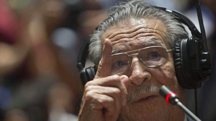 """Guatemala's former dictator Jose Efrain Rios Montt speaks during his genocide trial in Guatemala City, Thursday, May 9, 2013. The 86-year-old ex-general says he never ordered attacks against """"a race,""""denying he ordered the extermination of Ixil Mayas. Prosecutors say that while in power, Rios Montt was aware of, and thus responsible for, the slaughter of at least 1,771 Ixil Mayas in the towns of San Juan Cotzal, San Gaspar Chajul and Santa Maria Nebaj in Guatemala's western highlands. (AP Photo/Moises Castillo)"""