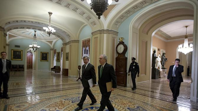 Sen. Mike Johanns, R-Neb., left, walks with Senate Minority Leader Mitch McConnell from Kentucky, to the Senate floor for a vote on the fiscal cliff, on Capitol Hill Tuesday, Jan. 1, 2013 in Washington. The Senate passed legislation early New Year's Day to neutralize a fiscal cliff combination of across-the-board tax increases and spending cuts that kicked in at midnight. (AP Photo/Alex Brandon)