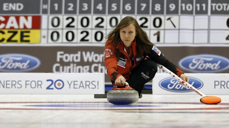 Canada's skip Rachel Homan delivers a stone during her draw against the Czech Republic at the World Women's Curling Championships in St.John