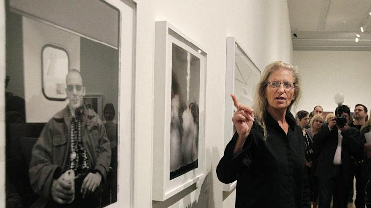 "Annie Leibovitz talks about some of her work during a tour of her exhibition at the Wexner Center for the Arts Friday, Sept. 21, 2012, in Columbus, Ohio. Leibovitz's exhibition features work from her ""Master Set,"" an authoritative edition of 156 images. (AP Photo/Jay LaPrete)"