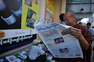 A Buddhist monk reads a copy of The Union daily newspaper in Yangon on April 1, 2013. Privately owned daily newspapers hit Myanmar's streets Monday for the first time in decades under new freedoms that represent a revolution for a media industry which was shackled under military rule