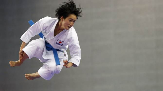 Japan's Kiyou Shimizu competes against Vietnam's Nguyen Hoang Ngan in the women's kata final of the karate competition  at Gyeyang Gymnasium during the 17th Asian Games in Incheon