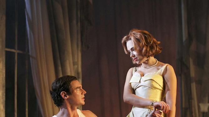"""This undated theater image released by Boneau/Bryan-Brown showsBenjamin Walker, left, and  Scarlett Johansson during a performance of """"Cat on a Hot Tin Roof,"""" playing at the Richard Rodgers Theatre in New York. (AP Photo/Boneau/Bryan-Brown, Joan Marcus)"""