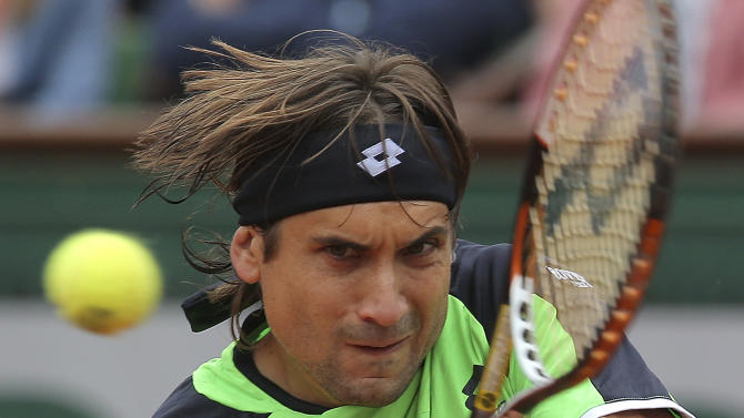 Spain's David Ferrer returns the ball to compatriot Rafael Nadal during the men's final match of the French Open tennis tournament at the Roland Garros stadium Sunday, June 9, 2013 in Paris. (AP Photo/Michel Euler)