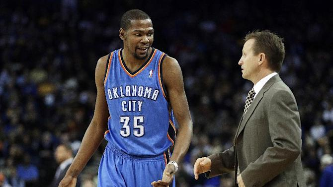 Oklahoma City Thunder's Kevin Durant (35) talks with head coach Scott Brooks during the first half of an NBA basketball game against the Golden State Warriors, Wednesday, Jan. 23, 2013, in Oakland, Calif. (AP Photo/Ben Margot)