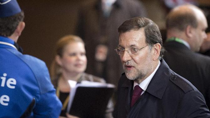 Spain's Prime Minister Mariano Rajoy, center, departs after an EU summit in Brussels on Friday, Nov. 23, 2012. The leaders of Britain and France staked out starkly different visions of Europe's future as talks in Brussels on how much the European Union should be allowed to spend, set the stage for a long, divisive and possibly inconclusive summit. (AP Photo/Geert Vanden Wijngaert)