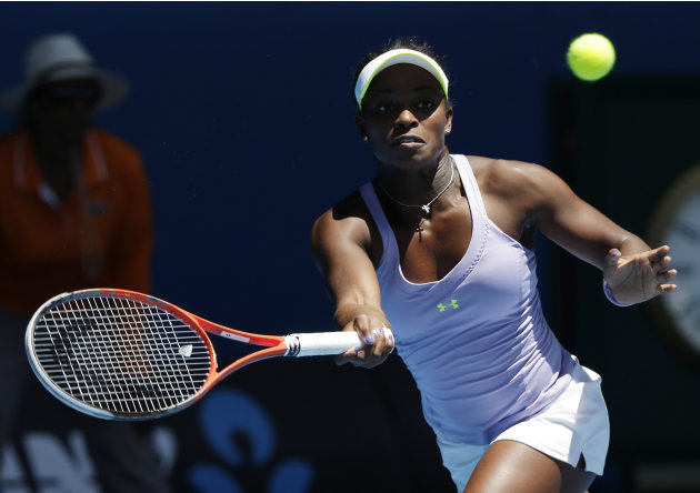 Sloane Stephens of the US hits a forehand return to compatriot Serena Williams during their quarterfinal match at the Australian Open tennis championship in Melbourne, Australia, Wednesday, Jan. 23, 2