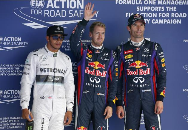 Mercedes Formula One driver Hamilton, Red Bull Formula One driver Vettel and Red Bull Formula One driver Webber pose after the qualifying session for the Korean F1 Grand Prix in Yeongam