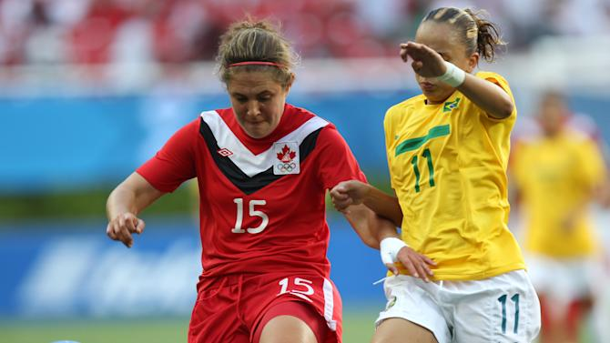 Brazil's Thais Guedes, left, and Canada's Shannon Woeller vie for the ball during a women's soccer gold medal match at the Pan American Games in Guadalajara, Mexico, Thursday, Oct. 27, 2011. (AP Photo/Juan Karita)