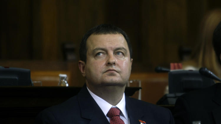 Serbia's prime minister designate, Ivica Dacic, front, looks on during a parliamentary session in Belgrade, Serbia, Thursday, July 26, 2012. Dacic, the wartime spokesman of late strongman Slobodan Milosevic, who has shifted away from the former patron but has also kept some of his trademark features, is set to become Serbia's new prime minister on Thursday, triggering unease despite his proclaimed pro-EU policies. (AP Photo/ Marko Drobnjakovic)