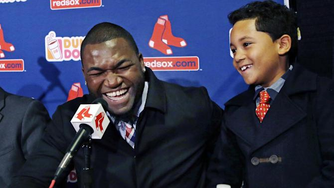 Boston Red Sox's David Ortiz laughs with his son D'Angelo, 8, during a baseball news conference, Monday, Nov. 5, 2012, at Fenway Park in Boston. Ortiz announced that he has finalized a $26 million, two-year contract, which includes bonuses that could raise the value to $30 million. (AP Photo/Elise Amendola)