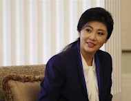 Thai Prime Minister Yingluck Shinawatra smiles during her meeting with Hong Kong Chief Executive Leung Chun-ying in Hong Kong February 26, 2013. REUTERS/Bobby Yip
