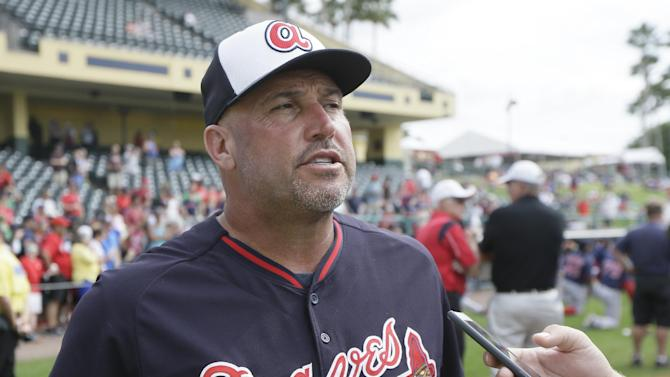 Atlanta Braves manager Fredi Gonzalez talks to the media before a spring training exhibition baseball game against the Boston Red Sox in Kissimmee, Fla., Friday, March 27, 2015. (AP Photo/Carlos Osorio)