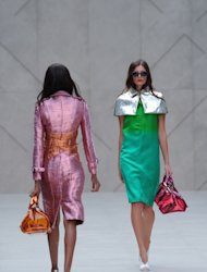 Models present creations during the Burberry Prorsum 2013 spring/summer collection catwalk show at London Fashion Week in London on September 17, 2012