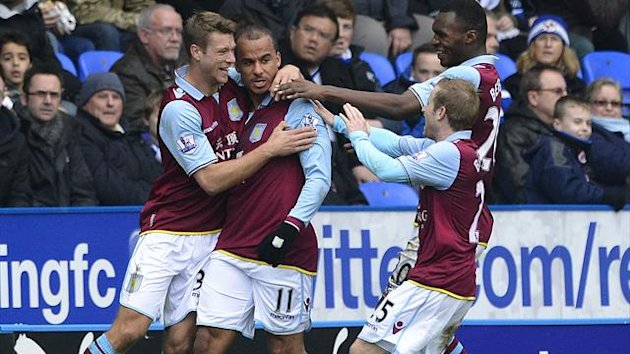 Aston Villa's Gabby Agbonlahor (2nd L) is congratulated after scoring against Reading during their English Premier League soccer match at The Madejski Stadium, Reading, southern England, March 9, 2013. (REUTERS)