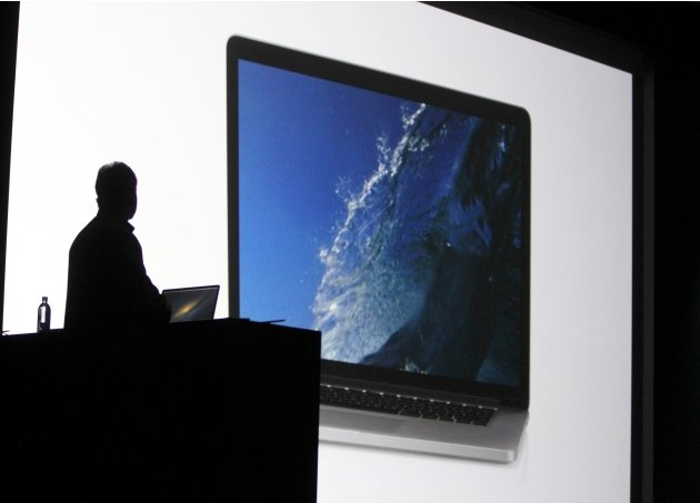 Phil Schiller, senior vice president of worldwide marketing at Apple Inc. watches video showing the new Macbook Pro during the Apple Worldwide Developers Conference 2012  in San Francisco