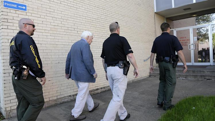 Kaufman county law enforcement officials escort an employee inside the county courthouse Monday, April 1, 2013, in Kaufman, Texas.   Law enforcement officials throughout Texas remained on high alert Monday seeking to better protect prosecutors and their staffs following the killing of county district attorney whose assistant was gunned down just months ago. (AP Photo/Tony Gutierrez)(AP Photo/Tony Gutierrez)