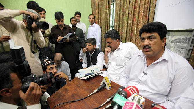 Jamil Afridi, right, brother of a Pakistani doctor Shakil Afridi speaks at a news conference in Peshawar, Pakistan on Monday, May 28, 2012. The brother of a doctor sentenced to 33 years for helping the United States track down Osama bin Laden, says that his brother is innocent and Pakistani trial that convicted him was a sham. (AP Photo/Mohammad Sajjad)