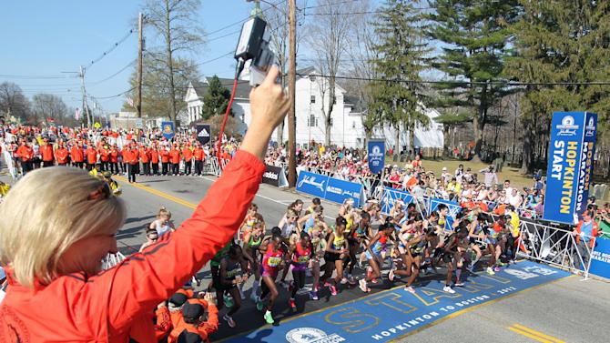 Allison Roe, the 1981 Boston Marathon women's champion, fires the starters pistol for the elite women's start of the 116th running of the Boston Marathon, in Hopkinton, Mass., Monday, April 16, 2012. (AP Photo/Stew Milne)